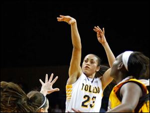 University of Toledo's forward Inma Zanoguera puts up a field goal during the first half of Thursday evening's home game against Central Michigan University.