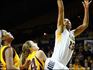 University of Toledo's forward Inma Zanoguera (23) lays up two points during the second half of Thursday evening's home game against Central Michigan University.