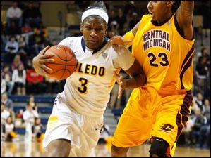 University of Toledo's forward Lecretia Smith (3) drives the lane under pressure from Central Michigan University's Jas'Mine Bracey (23) during the second half of Thursday evening's home game against Central Michigan University.