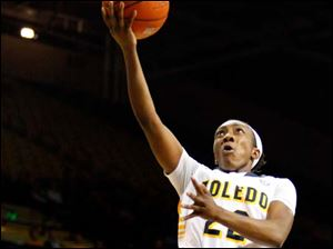 University of Toledo's guard Andola Dortch puts up two of her eight points off a fast break during the first half of Thursday evening's home game against Central Michigan University.