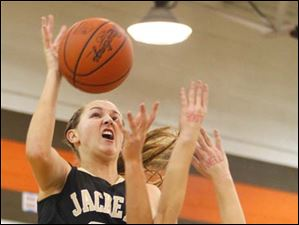Perrysburg's sophomore forward Allex Brown (35) pushes through a Southview defender on her way to the basket.