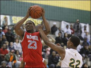 Start High School player Chris Adams, 22, fouls  Bowsher High School player Nate Allen, 23.