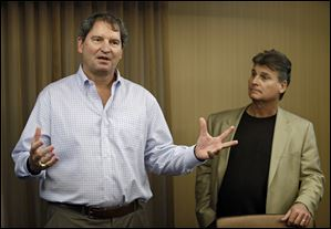 Former Cleveland Browns quarterback Bernie Kosar, left, speaks at a news conference with Dr. Rick Sponaugle, in Middleburg Heights on Thursday.