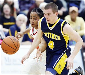 Whitmer's Luke Hickey (4) and Central Catholic's D.J. Moody chase a loose ball during their TRAC game Friday. Whitmer won 39-30.