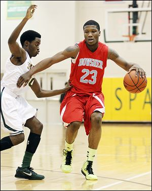 Bowsher's Nate Allen drives against Start's Keith Foreman in Friday night's game. Allen scored 27 points for the Rebels. Bowsher improved to 9-3, 4-1 in the City League.
