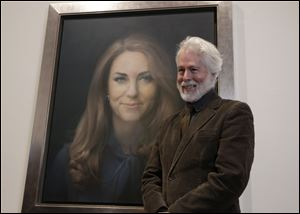 Artist Paul Emsley poses by his newly-unveiled first official portrait of Kate, Duchess of Cambridge, on display at the National Portrait Gallery in London.