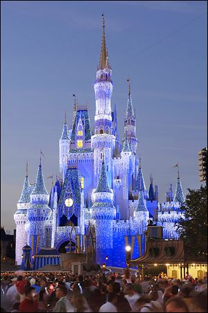 The iconic Cinderella Castle at Disney World in Florida glistens with 200,000 lights. Disney is trying to enhance its visitors' experience at the theme park and collect information on how the patrons use the park.