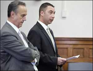 In 2010, Thomas White, right, with attorney Jerry Phillips, made a lengthy statement before being sentenced by Judge Gary Cook in Lucas County Common Pleas Court.  White, a former Ottawa Hills police officer, was sentenced to 10 years in prison.