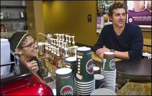 Patrick Dempsey's investment group has won the bid to purchase Tully's Coffee.