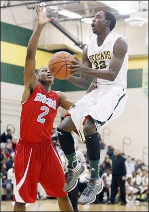 Start's Scott Hicks, who had 32 points, goes to the basket against Bowsher's Aundre Kizer.