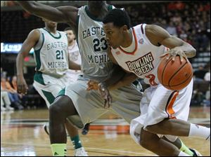 Bowling Green State University player Anthony Henderson, 2, drives past Eastern Michigan University player Glenn Bryant, 23, during the first half at Bowling Green State University.