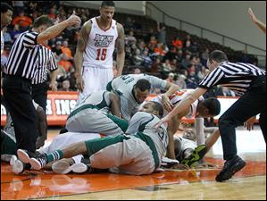 Bowling Green State University players battle for a loose ball with Eastern Michigan University players late in the second half at Bowling Green State University.