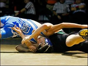 Defiance's Santana Villareal, left, grapples with Delta's James Dailey during the championship match in the 126 pound weight class of this year's Perrysburg Invitational Tournament Saturday at Perrysburg High School. Villareal won, 5-4.
