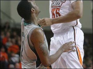Bowling Green State University player Cameron Black, 35, shoots over Eastern Michigan University player Da'Shonte Riley, 1, during the second half at Bowling Green State University.