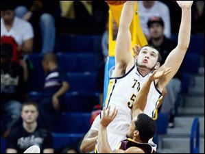 University of Toledo center Nathan Boothe (53) defends against  Central Michigan guard Kyle Randall (12).