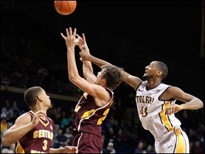 University of Toledo forward Matt Smith battles Central Michigan forward Blake Hibbitts (24) for a rebound.