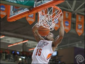 Bowling Green State University player A'uston Calhoun, 15, dunks during the second half against Eastern Michigan University at Bowling Green State University.
