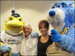 Jamie and Joy Farr with mascots from the Walleyes, Spike and Catrick, right.