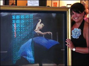 Tracy Fisher in front of a painting her father Jim Fisher gave her in honor of her upcoming 50th birthday at the reception for The Art of Robert Heindel at the Sur St. Clair Gallery.