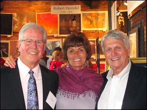 Gallery owner Richard Rideout, Rose Heindel, wife of the late Robert Heindel, and her husband Jim Fisher at the reception for The Art of Robert Heindel at the Sur St. Clair Gallery.