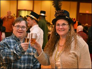 Rory Tillman and Stephanie Henderley toast the New Year at the party for individuals with developmental disabilities hosted by the Toledo area Inter-Agency Recreation Committee.