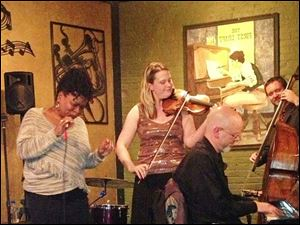 Former Perrysburg resident Sarah Connelly, center, hand an opportunity to play with Eric Dickey and Ramona Collins at Degage Jazz Cafe while visiting from Nashville.