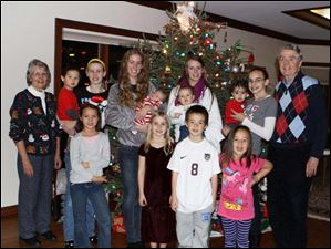 Sue Savage, far left, and Bob Savage, far right with their grandchildren. From left to right in the photo, Trinity Savage, Katie Bissell, Gabriel and Amelia Savage.  Back row - Max Savage, Sarah Ohlinger, Christy Ohlinger, Mica Savage, Amy Ohlinger, William Savage, Charlie Savage, and Megan Ohlinger.