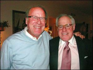 Peter Handwork, left, and Jim Tuschman celebrated their birthdays together at a dinner hosted by Sandy Blackstone Carman in her Perrysburg home.