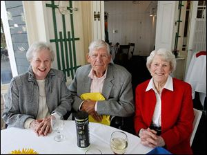Joan Haigh, left, Skip Fauver, center, and Annette Boice, right,  during the Toledo Country Club's 115th anniversary dinner in April.