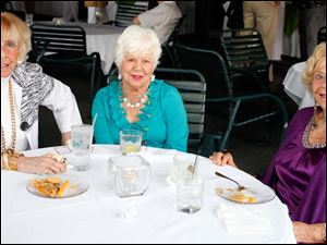 Left to right Jean Smith, Mary Anne Tigges, and Sally Kinn during the Toledo Animal Shelter picnic at the Belmont Country Club in Perrysburg.