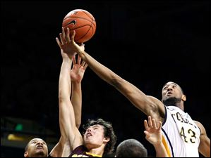 University of Toledo forward Matt Smith (43) battles Central Michigan forward Blake Hibbitts (24) for a rebound.