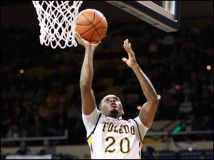 University of Toledo guard Julius Brown (20) goes to the net  against  Central Michigan guard Finis Craddock (5).