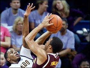 University of Toledo guard Julius Brown (20) defends against  Central Michigan guard Chris Fowler (15).