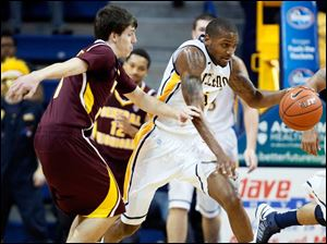 University of Toledo guard Rian Pearson (5) steals the ball from Central Michigan guard Spencer Krannitz (1).