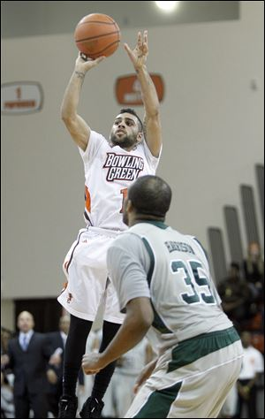Bowling Green State University player Jordon Crawford, 1, hits a three point shot with 6.1 seconds left to give the Falcons a 46-44 victory over Eastern Mic