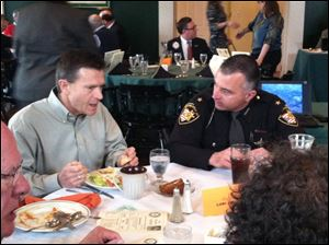 Perrysburg Rotary members Rick Gilts, left, former Perrysburg police chief, and Wood County Sheriff Mark Wasylyshyn chat before the sheriff's presentation on his trip to Israel at the Rotary Club's weekly luncheon.