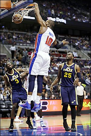 The Pistons' Greg Monroe dunks during the first quarter of Saturday's game against Utah.