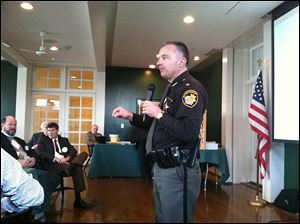 Wood County Sheriff Mark Washylyshyn tells fellow Rotary Club of Perrysburg members about his spring trip to Israel at the club's weekly luncheon Friday, at the Carranor Hunt and Polo Club in Perrysburg.