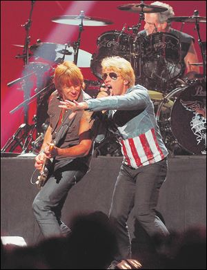 Jon Bon Jovi performs with Richie Sambora, left, at the MGM Grand Arena in Las Vegas.