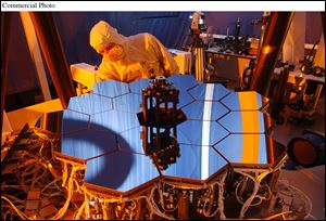 A Ball Aerospace engineer inspects the James Webb Space Telescope testbed telescope.