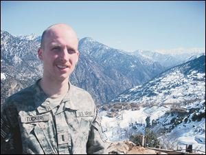 Kyle Tucker in the Afghan mountains above Combat Outpost Keating.