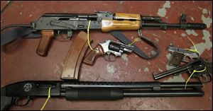 Among weapons in the Toledo police property room are a Romak 2, top, a Romanian-built variant of the AK-47. Its magazine is capable of holding 30 rounds.