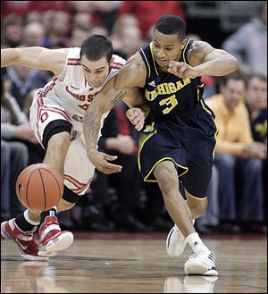 Aaron Craft, left, and Trey Burke fight for a loose ball in one of many battles the pair had on the afternoon.