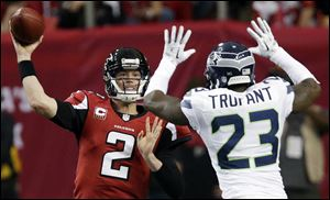 Atlanta Falcons quarterback Matt Ryan (2) throws against Seattle Seahawks cornerback Marcus Trufant (23) during the second half of an NFC divisional playoff NFL football game in Atlanta.