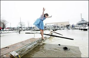 A participant prepares to plunge into the River Raisin during the 2012 event, which had 78 plungers. The Monroe County Special Olympics will be among the beneficiaries of the event.