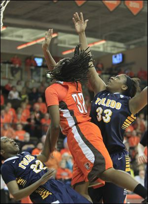 UT's Andola Dortch, left, takes one for the team as BGSU's Alexis Rogers is called for a foul late in the second half.