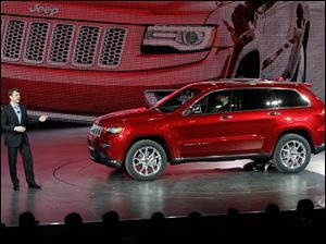 Jeep President and CEO Mike Manley speaks about the 2014 diesel Jeep Grand Cherokee Monday.