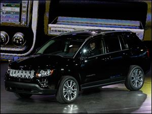 The 2014 Jeep Compass is unveiled at the North American International Auto Show in Detroit.