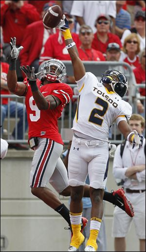 Toledo cornerback Taikwon Paige (2) bats down a pass intended for Ohio State wide receiver Verlon Reed (9)  during a 2011 game in Columbus.