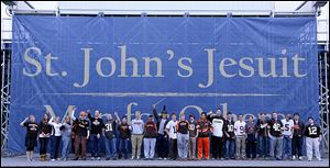 St. John's Jesuit students in Browns attire.